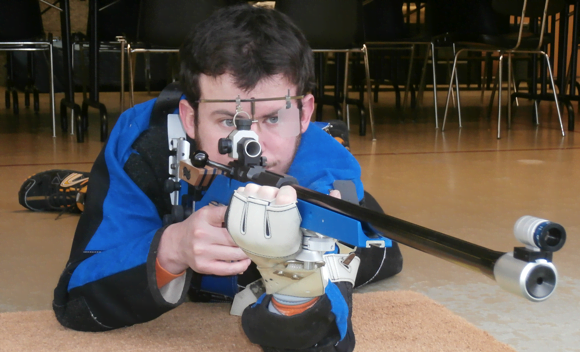 Engineering student Raphaël Chevalier demonstrates shooting in prone position