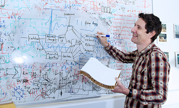 Trevor Cox writing on the white board in his office