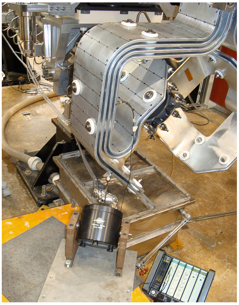During actual electrical pulse testing, three miniature triaxial accelerometers were mounted on the stripline