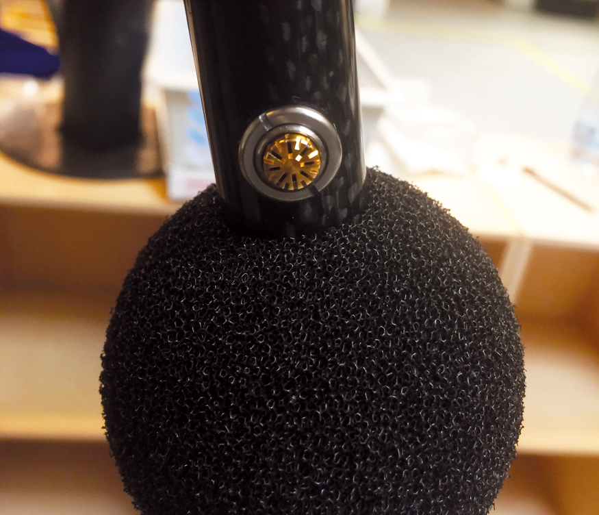 Close-up picture of a single microphone with the wind screen pushed aside