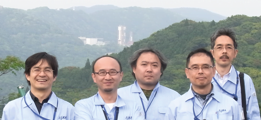 JAXA Engineers In front of Launchpad